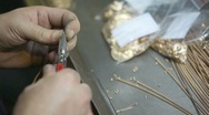 Process of cutting spiral gold wire into small pieces Stock Footage