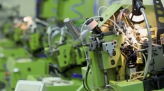 Several machines for manufacturing chains are in row - stock footage