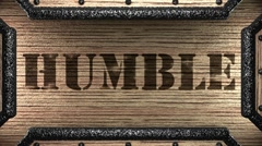 Humble on wooden stamp Stock Footage