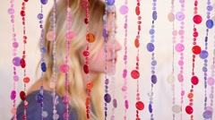 Girls portrait not in focus which stands pensively behind curtain Stock Footage