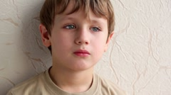 Little boy face on background of wall Stock Footage