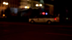 A police car with flares driving through an empty street - stock footage