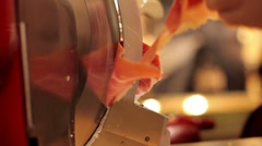 Seller cuts Jamon in store Stock Footage