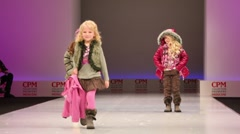 Three little girls in winter clothes from Snowimage Collection Stock Footage