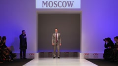 Man wear gray suit from Slava Zaytzev walk catwalk in Collection Premiere Moscow Stock Footage
