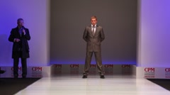 Man wear brown suit from Slava Zaytzev walk the catwalk Stock Footage