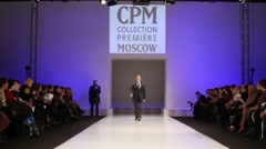 Man wear black suit from Slava Zaytzev walk the catwalk Stock Footage