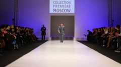 Man wear grey suit from Slava Zaytzev walk the catwalk Stock Footage