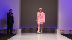 Man wear pink summer suit from Slava Zaytzev walk the catwalk Stock Footage