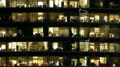 Windows in business city: people at work - stock footage