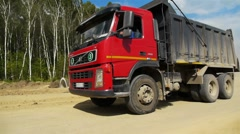 Red truck goes by Stock Footage