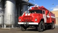 Red firetruck in fire department HD Footage