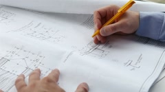 Engineer checks the construction drawings Stock Footage