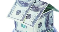 House made from dollar bills spinning, they with inscription souvenir Stock Footage