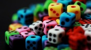 Stock Video Footage of many colorful dice stacked in pile rotate on black