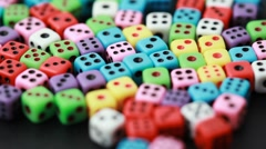 Many colorful dice rotate on black Stock Footage