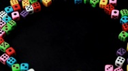 Stock Video Footage of many colorful dice stacked in circle rotate on black