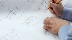 engineer checks the construction drawings - stock footage