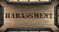 Harassment on wooden stamp Stock Footage