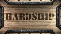 Hardship on wooden stamp Stock Footage