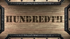 Hundredth on wooden stamp Stock Footage
