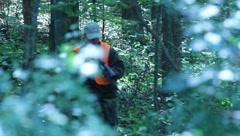 Hunter walking through woods(HD) c - stock footage