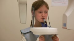 Girl getting a panoramic xray for purposes of orthodontics Stock Footage