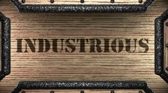 industrious on wooden stamp - stock footage