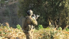 Soldiers scouting out area(HD) C - stock footage