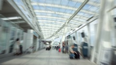 Blurred time lapse of traveler arriving at yvr Stock Footage