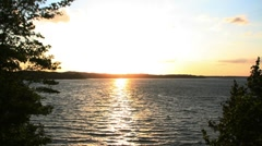 Time-lapse of a beautiful sunset over a lake. Stock Footage