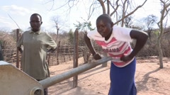 Kenya: Pumping for Water at the Borehole - stock footage