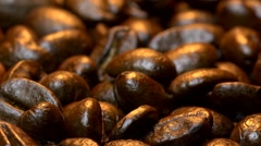 Slow flight (track) over warm roasted coffee beans Stock Footage
