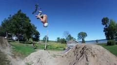 BMX backflip bail on dirt Stock Footage