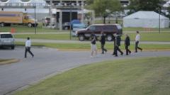 Stock Footage - Mitt Romney - Crossing media lot - on the way to debate Stock Footage