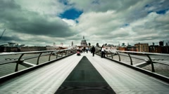 People on the Millenium Bridge - London - stock footage