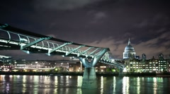 Millennium Bridge and St.Paul's Cathedral at night - stock footage