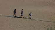 Finland YYteri people walking on beach Stock Footage