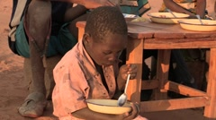 Kenya: Young Girl Eats Beans and Maize - stock footage