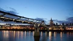 Timelapse of Millennium Bridge and St.Paul's Cathedral at night Stock Footage