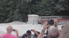 Stock Footage - Gaurd walks by crowd Stock Footage