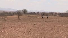 Kenya: Farmers Walk through Dry Field Stock Footage