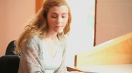 Stock Video Footage of Student showing her notes to her classmate