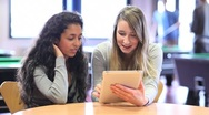 Fellow students using a tablet computer Stock Footage