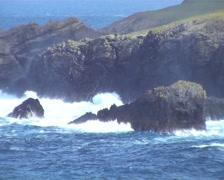 Waves crashing into coast of Shetland Islands Scotland Stock Footage