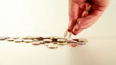 Hand dropping coins Stock Footage