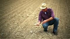 Farmer verifying soil; Full HD Photo JPEG Stock Footage