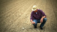Farmer verifying soil; Full HD Photo JPEG - stock footage