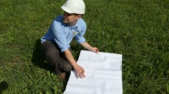 builder inspects the site of the future construction site - stock footage
