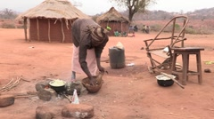 Kenya: Poor Woman Cooks Meal Stock Footage